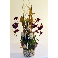 Orchid and Protea Paradise: ( natural colored reeds, silk pink and white Protea stems, silver grey ceramic base ,burgundy orchid clusters)