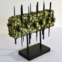 Green Lichen Block: ( natural green lichen embellished with stones and faux botanicals on black stand)