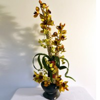 Honeycomb and Mahogany Orchids: (Natural botanicals form natural and mahogany colored cylinders, lime green and burgundy orchids, steel grey colored ceramic container )